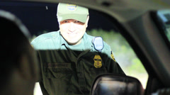 US Border Patrol Agent Interviews a Driver - stock footage