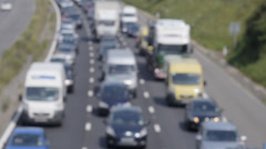 Out of focus slow traffic on M4 Motorway, UK Stock Footage