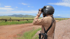 Border Patrol Agent with Binoculars  Stock Footage
