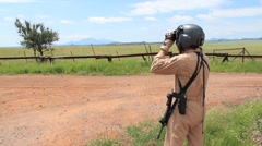 Border Patrol Agent with Binoculars  - stock footage