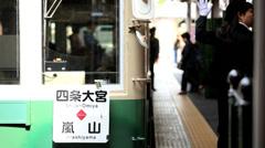 Japanese train station carriage Arashiyama people Kyoto Japan Asia Stock Footage