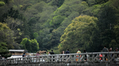 Tourists Togetsukyo Bridge Oi River Arashiyama Kyoto Japan Asia Stock Footage
