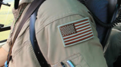 US Flag Patch on Shoulder of Helicopter Pilot Stock Footage