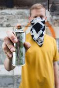 Boy after painting graffiti Stock Photos