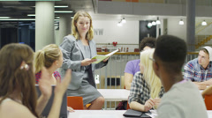 Female teacher in modern college teaching a class of students Stock Footage