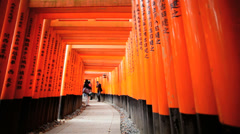 Tori gates Fushimi Inari Taisha shrine inscriptions Buddhist Kyoto Stock Footage