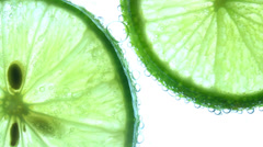 Sparkling water with a slice of lime Stock Footage