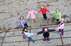Friendship and teamwork concept with young schoolgirls group Stock Photos