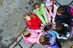 friendship and teamwork concept with young schoolgirls group - stock photo
