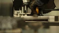 Man working cutting iron circular disk saw, making sparks Industrial work Stock Footage