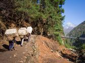Stock Photo of Sherpa Porters Walking Uphill, Everest Base Camp Trek, Nepal