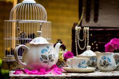 Stock Photo of Elegant tea set with fresh flowers on a garden table