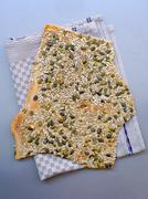 Flat bread with seeds - stock photo