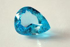 Blue gemstone on white background, studio shot Stock Photos