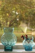 Glass vases on windowsill, oland, Sweden Stock Photos