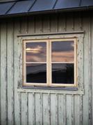 Sunset reflecting in window, Vastkusten, Sweden - stock photo