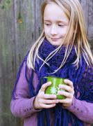 Smiling girl holding mug, oland, Sweden - stock photo