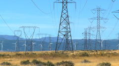 Electrical towers & wind turbines Stock Footage