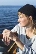 Smiling woman on boat, Sweden - stock photo