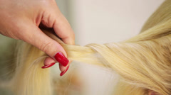 Weaving braids blonde Stock Footage