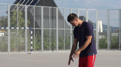 Slow-Mo: Basketball Player Practices Free Throw Stock Footage
