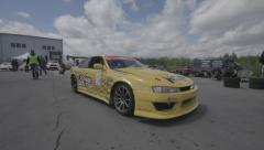 Yellow racing car on the parking - filmed with steadicam Stock Footage