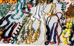 african origin vintage necklaces for sale at flea market stall - stock photo