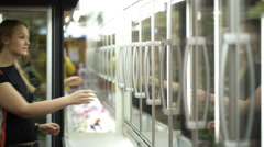 Young couple in the shop buying frozen food Stock Footage