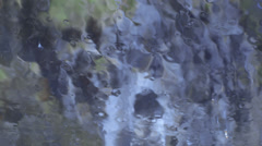 Rain on windshield and rocks in the background Stock Footage