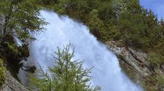 Waterfall between trees Stock Footage