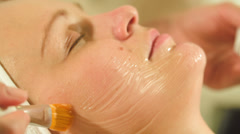 Woman under facial spa procedure Stock Footage