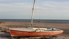 Abandoned sailboat by sea Stock Footage