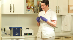 Female beautician starting sterilization of cosmetological instrument Stock Footage