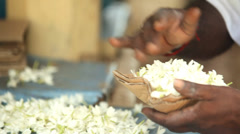 Close up view of making flower arrangements for temple offerings in Kandy. Stock Footage