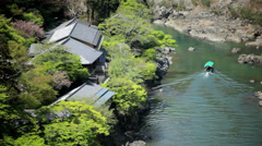 Japanese tourist boat Katsura River Arashiyama Kyoto Japan Asia Stock Footage