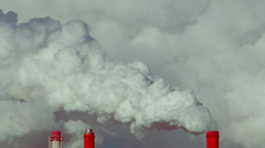 Fast motion of puffy clouds and pure steam from three stacks on gray background. Stock Footage