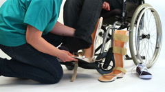Orthopedic equipment for young man in wheelchair Stock Footage