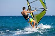 Stock Photo of rear view of young windsurfer