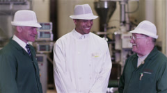 Portrait of team of smiling factory workers in the food and drink industry Stock Footage