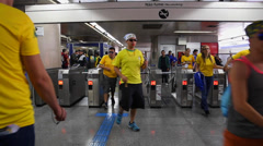Supporters leaving the subway on the World Cup 2014 Stock Footage