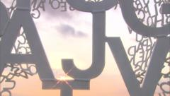 View Through Abstract Alphabet Statue with Sun Flare - stock footage