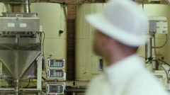 Portrait of friendly smiling factory worker in the food and drink industry Stock Footage