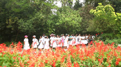 Local school girls in the botanical gardens in Kandy. Stock Footage