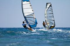 windsurfers in action - stock photo