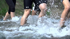 Sports team crossing river stream Stock Footage