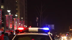 alarm lights on police car in downtown - stock footage