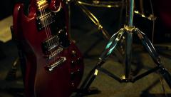 Electric Gibson SG Style Guitar on Stand - Panning Shot Stock Footage