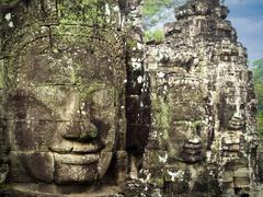 Giant Stone Faces at Bayon Temple at Angkor, Cambodia Stock Photos