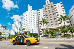 Famous art deco hotels and traffic  at collins avenue in miami b Stock Photos
