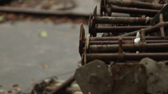Rusty bolts at construction site Stock Footage
